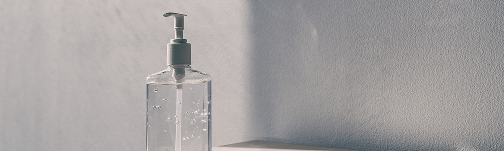Bottle of clear hand sanitizer on a desk
