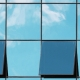 glass windows with clouds reflected on the surface